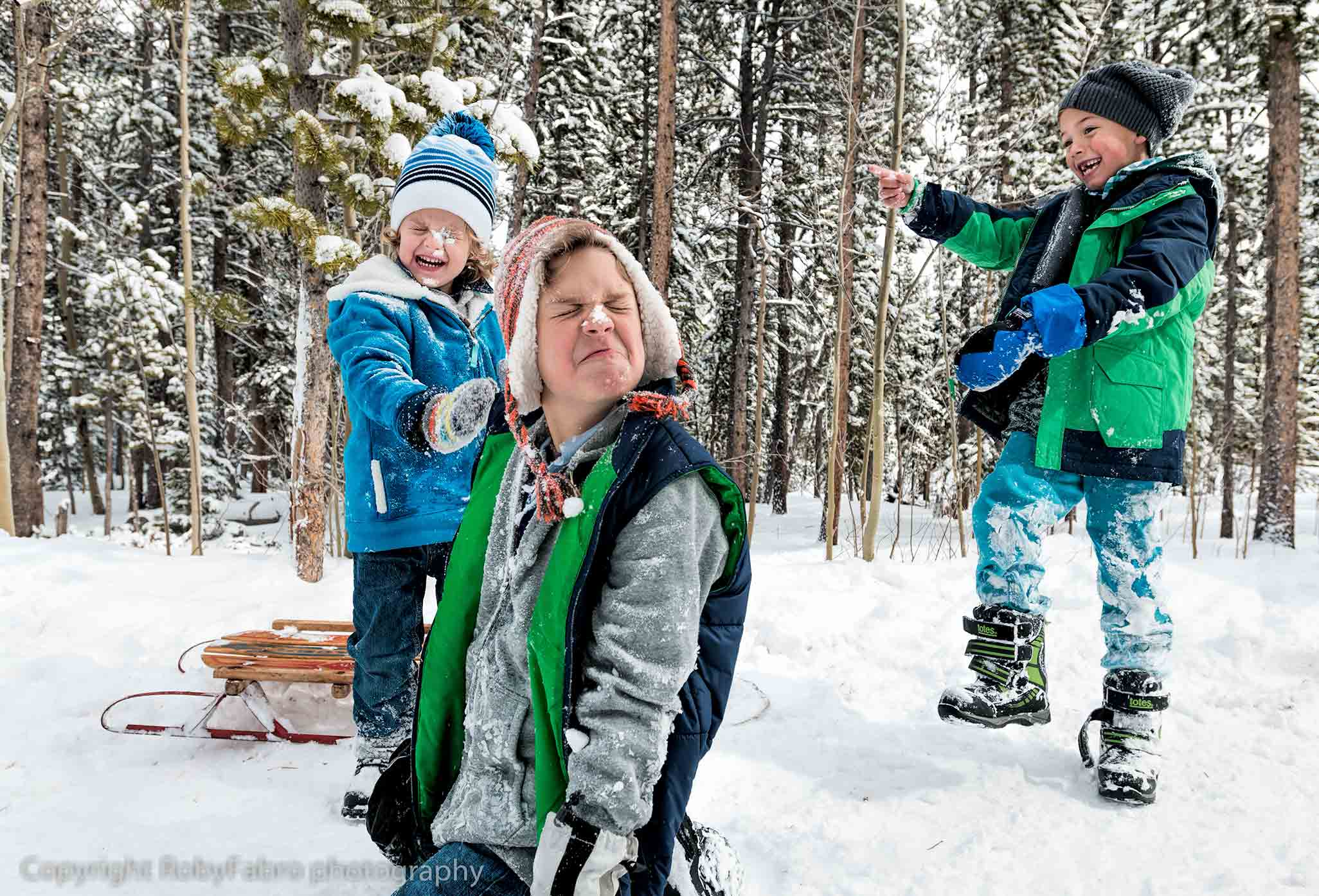 Kids having fun in the snow. Lifestyle photography,  Breckenridge, Colorado