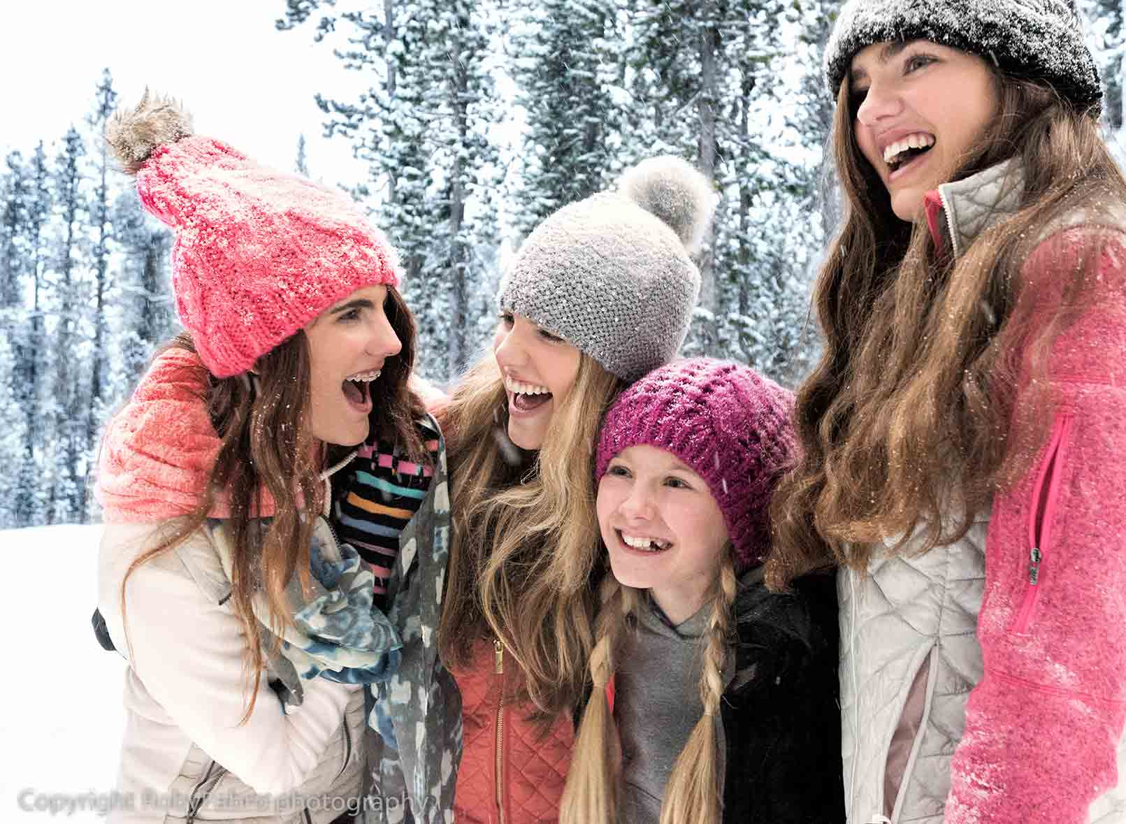 Girls bonding outside in a winter day.Breckenridge, Colorado. Lifestyle photography