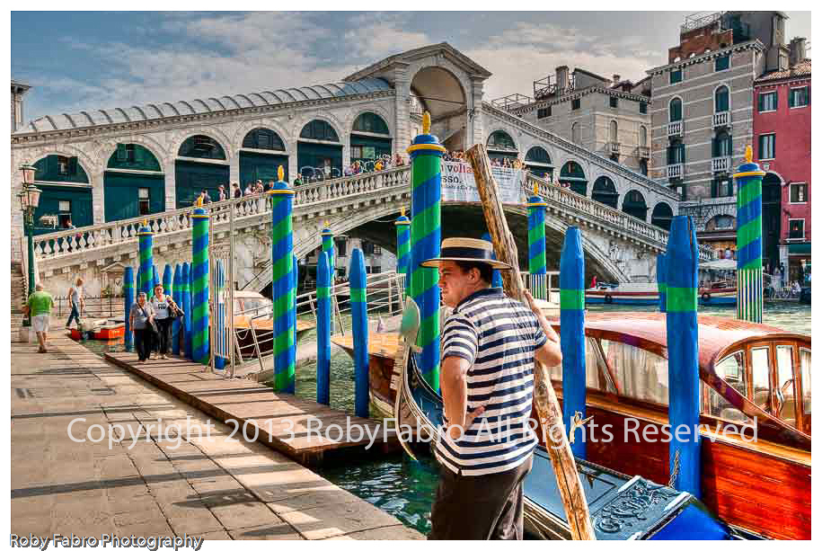 Venice Gondoliere waiting by the Rialto Bridge
